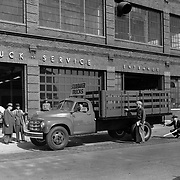 Studebaker 2R-Series trucks at South Bend's Freeman-Spicer dealership.  This image faces north on South Street.