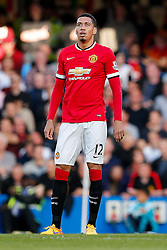 Chris Smalling of Manchester United looks dejected after Eden Hazard scores a goal to make it 1-0 - Photo mandatory by-line: Rogan Thomson/JMP - 07966 386802 - 18/04/2015 - SPORT - FOOTBALL - London, England - Stamford Bridge - Chelsea v Manchester United - Barclays Premier League.
