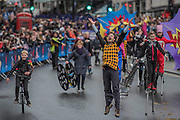A group of action heros on stilts and unicycles - The New Years day parade passes through central London form Piccadilly to Whitehall. London 01 Jan 2017
