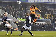 Inigo Calderon with a headed chance during the Sky Bet Championship match between Millwall and Brighton and Hove Albion at The Den, London, England on 17 March 2015. Photo by Michael Hulf.