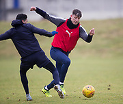 Dundee's Josh Meekings goes past Faissal El Bakhtaoui during Dundee FC training at the Michelin Grounds, Dundee<br /> <br /> <br />  - &copy; David Young - www.davidyoungphoto.co.uk - email: davidyoungphoto@gmail.com