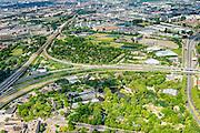 Nederland, Zuid-Holland, Rotterdam, 10-06-2015; Diergaarde Blijdorp in de Blijdorpse Polder, omgeven diverse spoorlijnen en autowegen. In de achtergrond Van Nelle fabriek en gevangenis De Schie.<br /> Blijdorp Zoo in the North of Rotterdam.<br /> luchtfoto (toeslag op standard tarieven);<br /> aerial photo (additional fee required);<br /> copyright foto/photo Siebe Swart