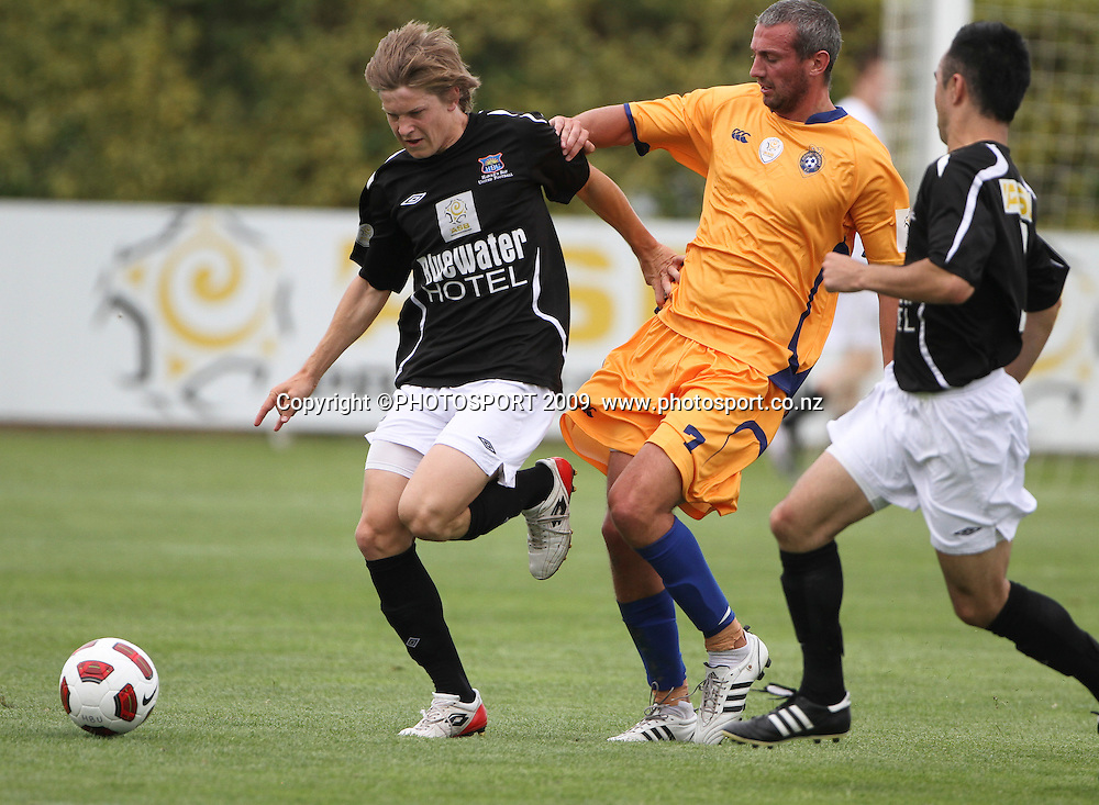 Hawkes Bay United's Andy Bevin fends off a tackle from Otago United's Nathan Knox, ASB Premiership Football, Hawkes Bay United v Otago. Park Island, Napier 14 November 2010. Photo: Bethelle McFedries / photosport.co.nz
