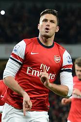 Arsenal's Oliver Giroud celebrates scoring a goal - Photo mandatory by-line: Mitchell Gunn/JMP - Tel: Mobile: 07966 386802 23/11/2013 - SPORT - Football - London - Emirates Stadium - Arsenal v Southampton - Barclays Premier League