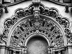 Detail of the facade of the Million Dollar Theater in downtown Los Angeles. The theater was one of the first movie palaces in the United States. It was built in 1917 by  movie theater owner Sid Grauman.  Sculptor Joseph Mora was responsible for the exterior ornamentation.