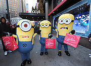 "The Minions shop at Macy's Herald Square, Monday, Nov. 25, 2013, in New York, to celebrate the release of ""Despicable Me 2"" on Digital HD on November 26 and Blu-ray and DVD on December 10.  The Minions took over Manhattan in preparation for their appearance in the 84th annual Macy's Thanksgiving Day Parade.  (Photo by Diane Bondareff/Invision for Universal Studios Home Entertainment/AP Images)"