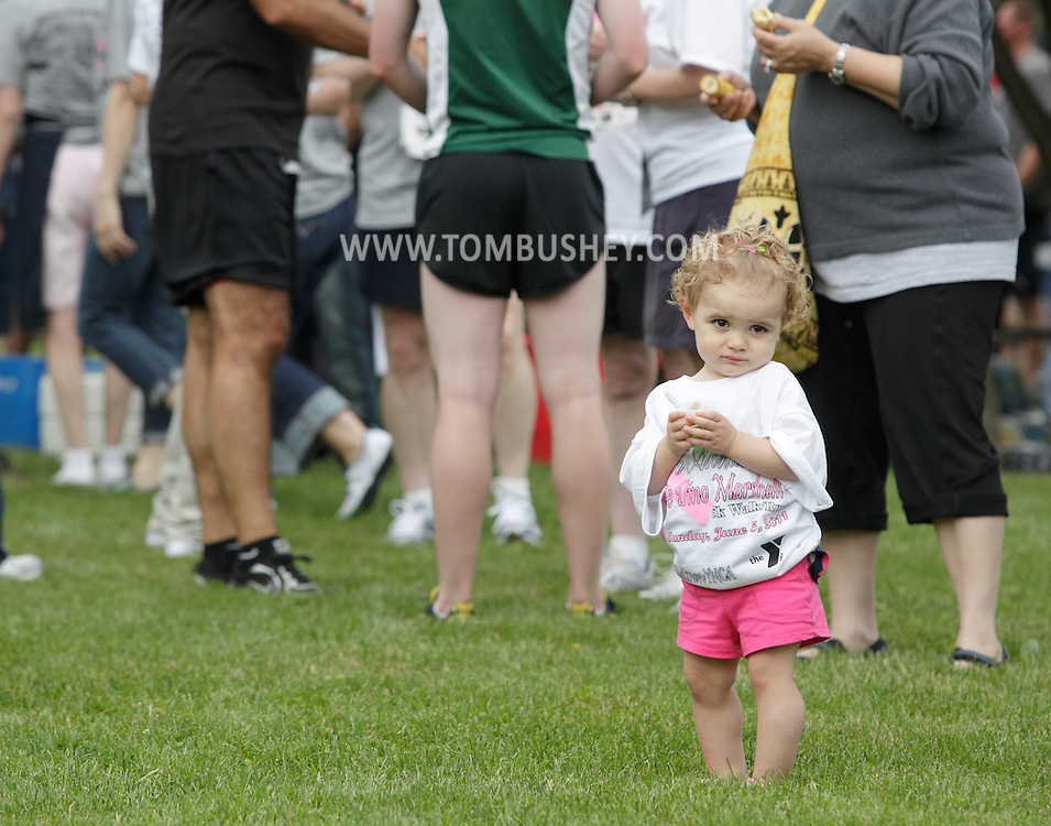 Middletown, New York - People of all ages enjoy the post-race party after the 15th annual Ruthie Dino Marshall 5K Run and Fun Walk hosted by the Middletown YMCA on Sunday, June 5, 2011.