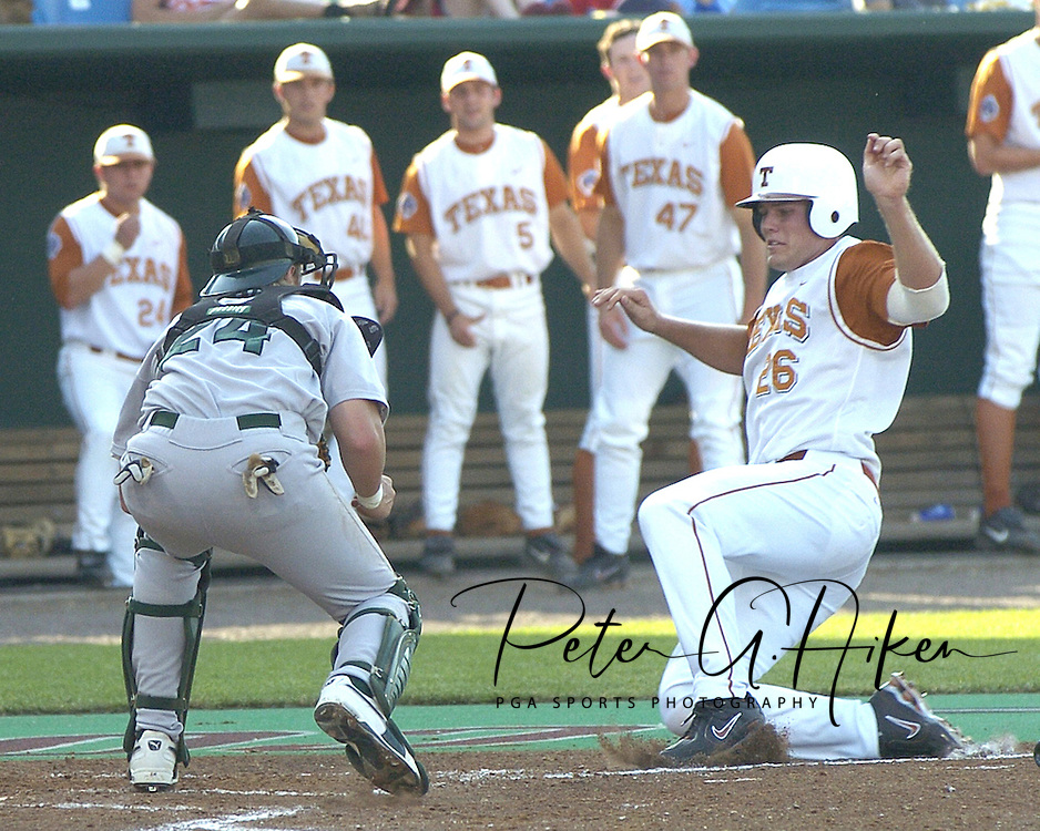 Will Crouch (26) of Texas is out at the plate, as Tulane catcher Greg Dini (L) blocks the plate for the out in the bottom of the first inning.  Baylor defeated Oregon State 4-3 in ten innings and eliminated OSU from the College World Series at Rosenblatt Stadium in Omaha, Nebraska on June 20, 2005.