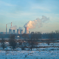 A nuclear power station in Southern Poland billows steam in the frozen air, trying to keep the lights and heat on despite aging Soviet equipment and technology.