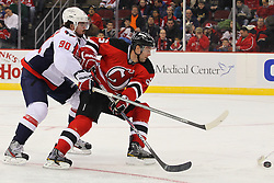 Jan 25, 2013; Newark, NJ, USA; New Jersey Devils defenseman Andy Greene (6) battles Washington Capitals center Marcus Johansson (90) for the loose puck during the second period at the Prudential Center.
