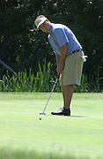 Defending Michigan Amateur Champion Christian Vozza of Traverse City watches birdie putt attempt on the 6th hole of the Heather course at Boyne Highlands.