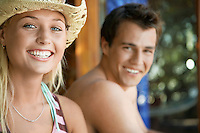 Young couple smiling head and shoulders