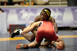 London, Ontario ---2013-03-02---    Golden Musonza of  University Of Regina takes on  Brian Cowan of  Brock in the men's 54 KG bronze medal match at the 2012 CIS Wrestling Championships in London, Ontario, March 02, 2013. .GEOFF ROBINS/Mundo Sport Images