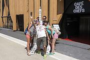 A group of visitors take a selfie posing around a model of the Tour Eiffel at France pavilion of Expo 2015, Rho-Pero, Milan, July 2015. &copy; Carlo Cerchioli<br /> <br /> Un gruppo di visitatori si fa un selfie intorno ad un modello della Tour Eiffel al padiglione Francia di Expo 2015, Rho-Pero, Milano, luglio 2015.