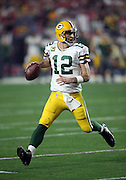 Green Bay Packers quarterback Aaron Rodgers (12) rolls to his right as he looks to throw a third quarter pass during the NFL NFC Divisional round playoff football game against the Arizona Cardinals on Saturday, Jan. 16, 2016 in Glendale, Ariz. The Cardinals won the game in overtime 26-20. (©Paul Anthony Spinelli)