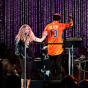 July 13, 2013 - New York, NY : <br /> The New York Philharmonic, lead by Alan Gilbert, standing at right, and accompanied by Mariah Carey, standing at left, perform in the free MLB All-Star Charity Concert to benefit Hurricane Sandy victims, in Central Park's great lawn on July 13, 2013. <br /> CREDIT: Karsten Moran for The New York Times