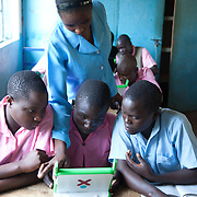 The Stars Foundation visiting Action in the Community Environment (ACE) in Bungoma, Kenya...Mabanga Primary School Child To Child club where the children are learning IT and life skills. Hardly any of the children have ever seen a computer or laptop not to mention used one. Here the children learn using a simple word programme, typing up text provided by the teachers running the work-shop. The text is about HIV/AIDS and through that the children also get to learn about HIV/AIDS and what that means. They also record themselves singing and get to play back the recordings so that they see themselves perform on video just made, which to many was an amazing experience.  ACE helped facilitate the donation of laptops from the charity Hands of Charity.