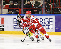 2020-03-06   Ljungby, Sverige: Bodens HF (62) Alfons Nordberg och Troja-Ljungby (3) Kevin Karlsson under matchen i Hockeyettan mellan IF Troja/Ljungby och Bodens HF i Ljungby Arena ( Foto av: Fredrik Sten   Swe Press Photo )<br /> <br /> Nyckelord: Ljungby, Ishockey, Hockeyettan, Ljungby Arena, IF Troja/Ljungby, Bodens HF, fstb200306, playoff, kval