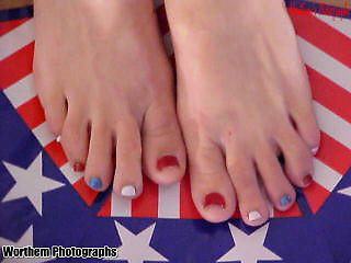 This is a female model showing here patriotic duty with her toenails colored red, white & blue.