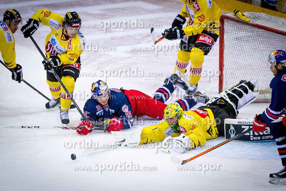20.12.2013, Albert Schultz Eishalle, Wien, AUT, EBEL, UPC Vienna Capitals vs EC Red Bull Salzburg, 55. Runde, im Bild Dustin Sylvester, (UPC Vienna Capitals, #12), Michael Boivin, (EC Red Bull Salzburg, #28), Matthew Zaba, (UPC Vienna Capitals, #1)// during the Erste Bank Icehockey League 55th Round match between UPC Vienna Capitals and EC Red Bull Salzburg at the Albert Schultz Ice Arena, Vienna, Austria on 2013/12/20. EXPA Pictures © 2013, PhotoCredit: EXPA/ Sebastian Pucher