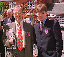 Left to right, the Foreign Secretary MR ROBIN COOK MP and his son MR CHRIS COOK, at a race meeting in Berkshire on 25th July 1998.MJF 40 2ORO