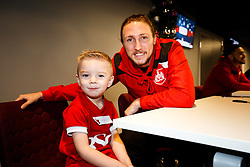 Luke Ayling of Bristol City signs autographs as Season ticket holders and members of Bristol Sport 7s and Forever Bristol take part in a Bristol Sport Christmas Party - Mandatory byline: Rogan Thomson/JMP - 22/12/2015 - SPORT - Ashton Gate Stadium - Bristol, England - Bristol Sport Christmas at Ashton Gate.