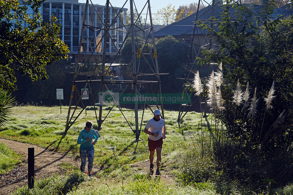 JOHANNESBURG SOUTH AFRICA - MAY 01 South Africans take to the streets in the stage 4 exercise period of between 6-9am on May 01, 2020 in Johannesburg South Africa. South Africa moved down to Level 4 of the national lockdown with relaxed restrictions as part of a risk adjusted 5 stage phasing of lockdown measures. This includes exercise within a 5km radius of homes and no organised groups, facemasks are mandortory. (Photo by Gallo Images/ Dino Lloyd)