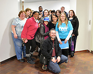 Melville, New York, USA. 24th January 2017. Members of Together We Will Long Island pose for group photo with (center of back row) GARRETT ARMWOOD, Long Island Regional Director for U.S. Senator Chuck Schumer of New York, at end of TWWLI drop in visit to Schumer's Melville office to share their concerns, especially about Trump's Cabinet appointees, #SwampCabinet. This Stop Trump Tuesday, #StopTrumpTuesday, event was part of nationwide political movement. L-R, in front are JILL PARNES of Plainview, (coral sweater) TEDRA GRANT of Dix Hills, (blue 'We're Still Here' cap) ANDREA ROSS BOYLE of Dix Hills, (kneeling) JUAN ALICEA of Medford, (blue TWWLI shirt) SUE MOLLER of Merrick, and (black jacket) LAURIE MITCHELL of West Babylon. Members of organizations such as MoveOn, Indivisible, and TWW plan to visit their Senators' offices each Tuesday duringTrump's first 100 days of presidency.