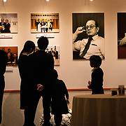 """TOKYO, JAPAN - MARCH 21 : People look at the photographs of the late Masaya Nakamura, The founder of video game company Bandai Namco and known as the """"father"""" of Pac-Man during the memorial ceremony in Tokyo, Japan on March 21, 2017. (Photo by Richard Atrero de Guzman ANADOLU Agency)"""