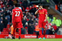 Dejan Lovren and Divock Origi of Liverpool looks dejected - Mandatory by-line: Matt McNulty/JMP - 21/01/2017 - FOOTBALL - Anfield - Liverpool, England - Liverpool v Swansea City - Premier League