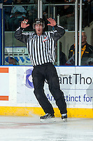 KELOWNA, CANADA -FEBRUARY 1: Spencer Lockert, linesman, makes a call at the Kelowna Rockets against the Kamloops Blazers on February 1, 2014 at Prospera Place in Kelowna, British Columbia, Canada.   (Photo by Marissa Baecker/Getty Images)  *** Local Caption *** Spencer Lockert; referee; Official; linesman;