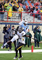 North Carolina's Dwight Jones (83) catches the ball in the end zone scoring for a touchdown over Missouri defensive back E.J. Gaines (31) in the first half of their Independence Bowl college football game, Monday, Dec. 26, 2011, in Shreveport, La.
