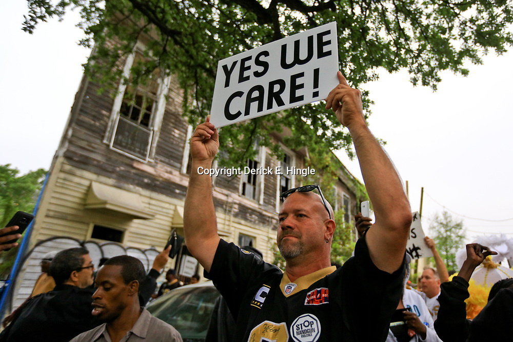 Apr 15, 2016; New Orleans, LA, USA; A man holds up a sign during a second-line parade on Camp street near Half Moon Bay bar for a tribute march to the retired NFL athlete Will Smith memorial at Sophie B. Wright Place and Felicity Street. Smith was shot and killed late Saturday night at the memorial location after being involved in a minor traffic accident. Mandatory Credit: Derick E. Hingle-USA TODAY Sports