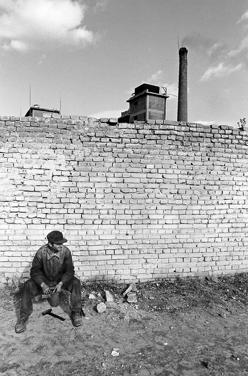 ALBANIA - Albanien - 1991 - Transition from communism to democracy; Closed factory and worker outside Tirana; 10/1991; © Christian Jungeblodt