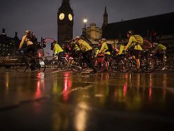 © Licensed to London News Pictures. 09/01/2017. London, UK. Cyclists pass Big Ben as a 24 hour London Underground tube strike takes hold.  All Zone one tube stations are closed until 6PM tonight after members of the RMT and the Transport Salaried Staffs' Association unions walked out after talks with TFL collapsed.  Photo credit: Peter Macdiarmid/LNP