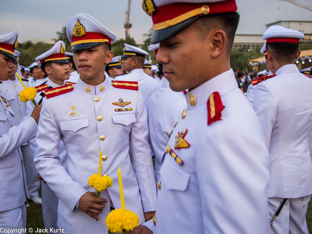 05 DECEMBER 2013 - BANGKOK, THAILAND:  Thai military personnel at the celebration of the birthday of the King. Thais observed the 86th birthday of Bhumibol Adulyadej, the King of Thailand, their revered King on Thursday. They held candlelight services throughout the country. The political protests that have gripped Bangkok were on hold for the day, although protestors did hold their own observances of the holiday. Thousands of people attended the government celebration of the day on Sanam Luang, the large public space next to the Grand Palace in Bangkok.    PHOTO BY JACK KURTZ