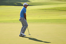 September 24, 2017 - Atlanta, Georgia, United States - Xander Schauffele reacts after putting for birdie and the win on the 18th green during the final round of the TOUR Championship at the East Lake Club. (Credit Image: © Debby Wong via ZUMA Wire)