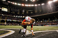 CAPTION: (New Orleans 12/02/07) (photo#4) Bucs quarterback Luke McCown (12) kneels in prayer alone on the field following a Bucs win over the Saints thanks to McCown's fourth quarter touchdown pass to Bucs tight end Jerramy Stevens (86) during the Tampa Bay Buccaneers vs. New Orleans Saints Sunday (12/2/07)..BRENDAN FITTERER | Times.SUMMARY:  Tampa Bay Buccaneers vs. New Orleans Saints
