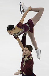 Cali Fujimoto and Nicholas Barsi-Rhyne perform during the championship pairs free skate competition at the U.S. Figure Skating Championships Saturday, Jan. 21, 2017, in Kansas City, Mo. (AP Photo/Colin E. Braley)