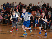 Gilford's Connor Sullivan has his eye on the basket against Sanbornton's Jacob Seavey and Garret Mango during the Senior Boys division game of the 21st annual Francoeur Babcock Basketball Tournament  Friday evening.  (Karen Bobotas/for the Laconia Daily Sun)