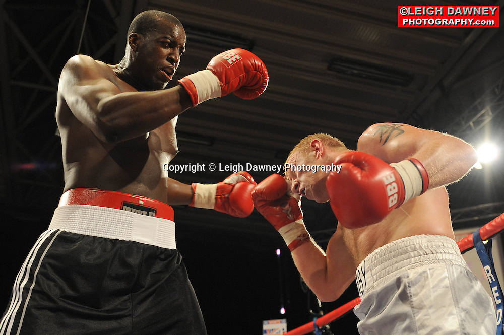 Damien Campbell (black shorts) defeats Lee Swaby at the Doncaster Dome, Doncaster on 2nd July 2010. Frank Maloney Promotions. Photo credit: © Leigh Dawney