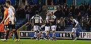 Millwall celebrate their third of the game during the The FA Cup match between Millwall and Flyde at The Den, London, England on 7 November 2015. Photo by Michael Hulf.