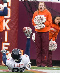 VT cheerleaders react after Virginia safety Byron Glaspy (22) intercepts a pass.  The Virginia Tech Hokies defeated the Virginia Cavaliers 17-14 in NCAA football at Lane Stadium on the campus of Virginia Tech in Blacksburg, VA on November 29, 2008.