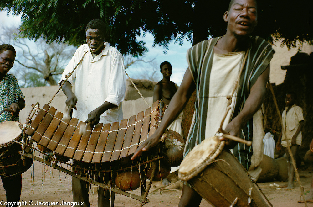 Musicians of Bobo tribe playing drums and balafon xylophone in Koumbia, Burkina Faso, Africa.