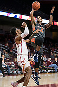 Pepperdine Waves guard Jade' Smith (5) shoots over Southern California Trojans guard Elijah Weaver (3) during an NCAA college basketball game, Tuesday, Nov. 19, 2019, in Los Angeles. USC defeated Pepperdine 91-84. (Jon Endow/Image of Sport)