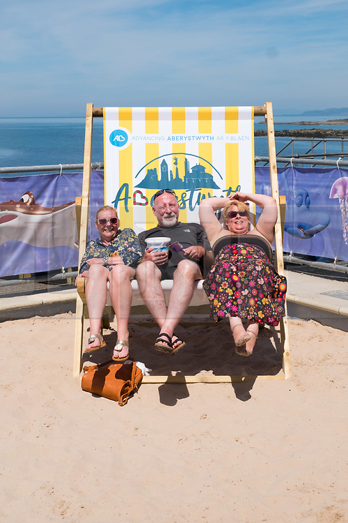 © Licenced to London News Pictures<br /> 25 June 2018 . Aberystwyth Wales UK<br /> UK Weather: People at the seaside  in Aberystwyth, on yet another scintillating day of hot unbroken sunshine.<br /> The UK is heading  into a mini heatwave, with temperatures forecast to hit 29º or 30º Celsius by the middle of the week<br /> photo crtedit: Keith Morris / LNP
