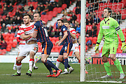 Doncaster Rovers defender Andrew Butler (6)  battles with Blackpool defender Tom Aldred (15)  during the Sky Bet League 1 match between Doncaster Rovers and Blackpool at the Keepmoat Stadium, Doncaster, England on 28 March 2016. Photo by Simon Davies.