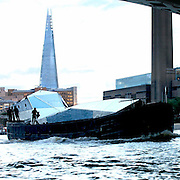EXCLUSIVE<br /> Floating art installation on the Thames – for a pricey £1.2 million.<br /> <br /> Art lovers are being given the chance to indulge in their craft by buying a floating art installation on the Thames – for a pricey £1.2 million.<br /> Immersive artwork Fluxland was launched down the river by renowned artist Cyril de Commarques as part of the Totally Thames festival.<br /> The mirrored superstructure is designed to reflect and distort the cityscape as she makes her way along the famous river, throwing light out at her onlookers.<br /> The remarkable boat, at Imperial Wharf, Fulham, is now on the market with the hefty price tag.<br /> Fluxland offers a unique opportunity to own a genuine work of art which has been built to be an artist's studio which can be lived and worked on.<br /> The accommodation includes a wheel house, internal mezzanine viewing deck, two double bedrooms – one with en suite – fully-fitted kitchen and a large open gallery / performance space and study.<br /> The interior features use of steel and concrete with huge expanses of glass offering views of the City as the occupier works, entertains or relaxes.<br /> ©Exclusivepix Media