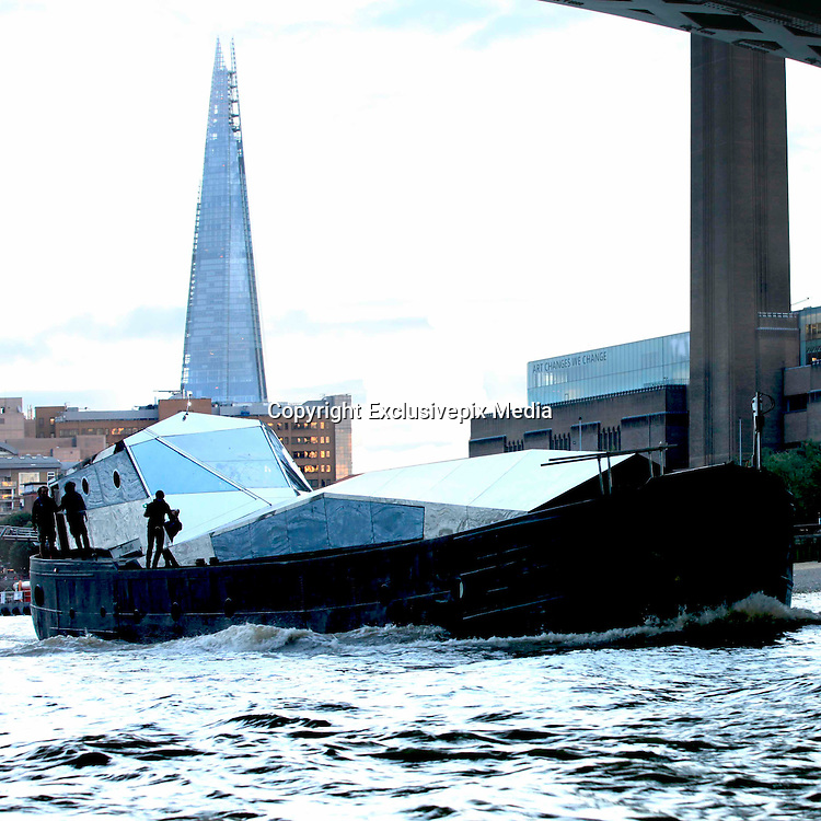 EXCLUSIVE<br /> Floating art installation on the Thames &ndash; for a pricey &pound;1.2 million.<br /> <br /> Art lovers are being given the chance to indulge in their craft by buying a floating art installation on the Thames &ndash; for a pricey &pound;1.2 million.<br /> Immersive artwork Fluxland was launched down the river by renowned artist Cyril de Commarques as part of the Totally Thames festival.<br /> The mirrored superstructure is designed to reflect and distort the cityscape as she makes her way along the famous river, throwing light out at her onlookers.<br /> The remarkable boat, at Imperial Wharf, Fulham, is now on the market with the hefty price tag.<br /> Fluxland offers a unique opportunity to own a genuine work of art which has been built to be an artist&rsquo;s studio which can be lived and worked on.<br /> The accommodation includes a wheel house, internal mezzanine viewing deck, two double bedrooms &ndash; one with en suite &ndash; fully-fitted kitchen and a large open gallery / performance space and study.<br /> The interior features use of steel and concrete with huge expanses of glass offering views of the City as the occupier works, entertains or relaxes.<br /> &copy;Exclusivepix Media