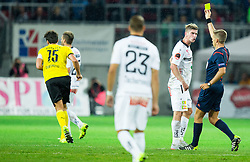 Mats Hummels of Borussia Dortmund (L) with yellow card after faulting Tadej Trdina of WAC (white) during football match between WAC Wolfsberg (AUT) and  Borussia Dortmund (GER) in First leg of Third qualifying round of UEFA Europa League 2015/16, on July 30, 2015 in Wörthersee Stadion, Klagenfurt, Austria. Photo by Vid Ponikvar / Sportida